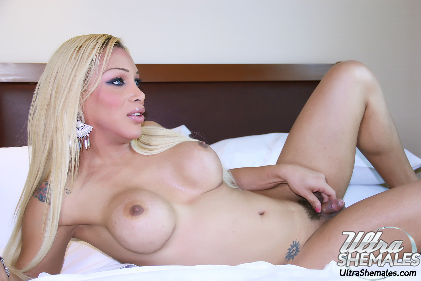 Yummy blonde tranny Solanch with a nice set of tits bending over for you (9/13)